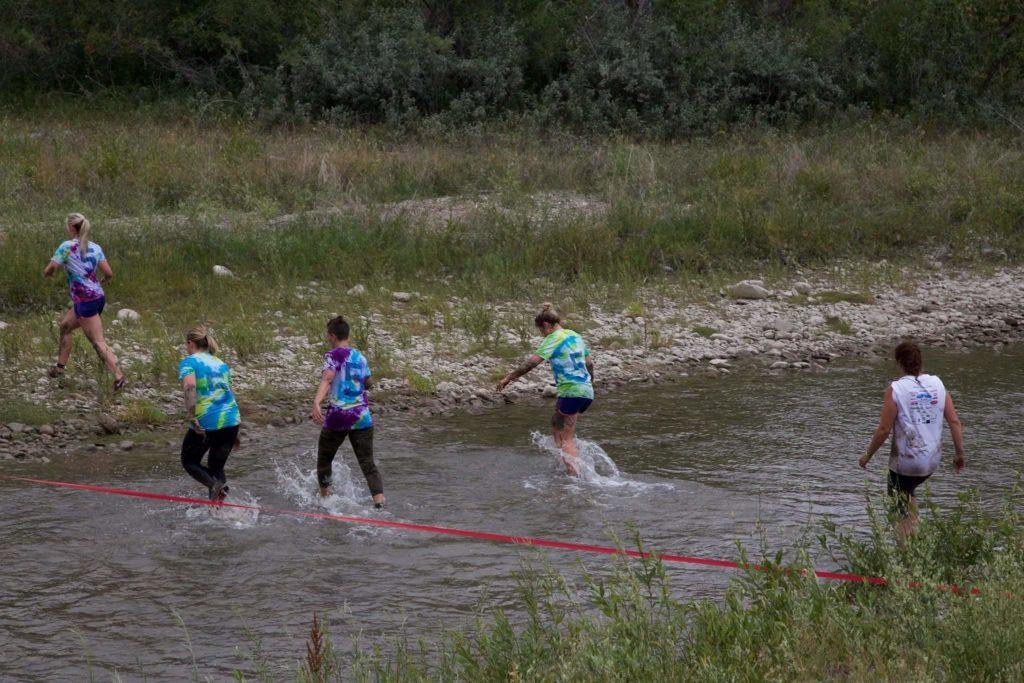 Muddy Warrior River runners
